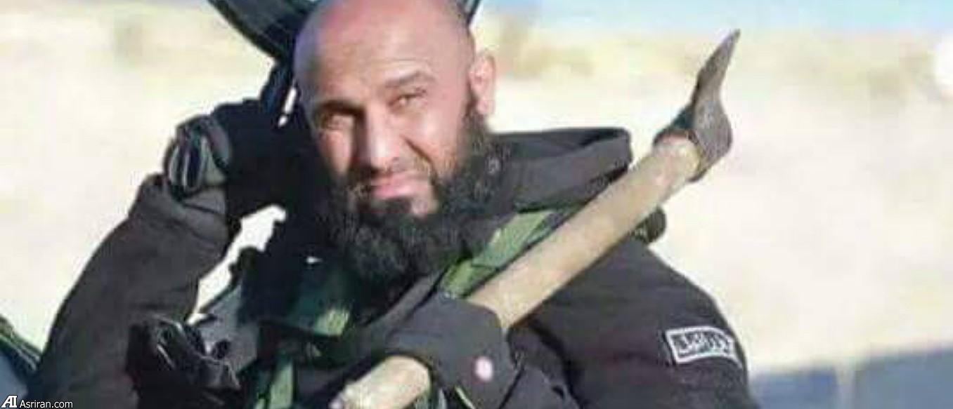 عزراییل داعشی ها؛ یک دست تبر ، یک دست تفنگ (+عکس)
