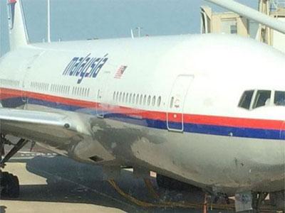 آخرین تصویر از هواپیمای مالزی سرنگون شده (+عکس)