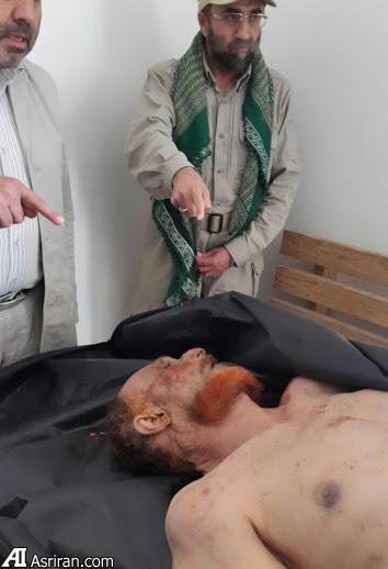 سردار باقر زاده بالای سر جنازه معاون صدام (عکس)