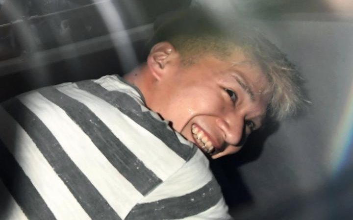 لبخند قاتل ژاپنی به دوربین های خبرنگاران (+عکس)