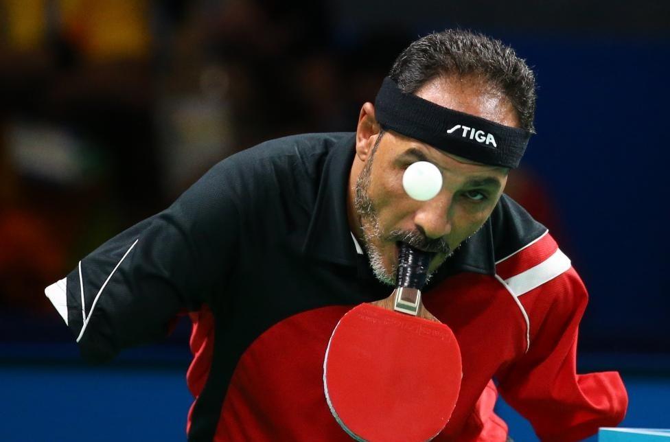 پینگپنگبازی که دست ندارد (عکس)