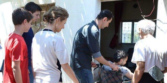 دیدار بشار اسد با خانوادههای زخمیهای ارتش سوریه (+عکس)