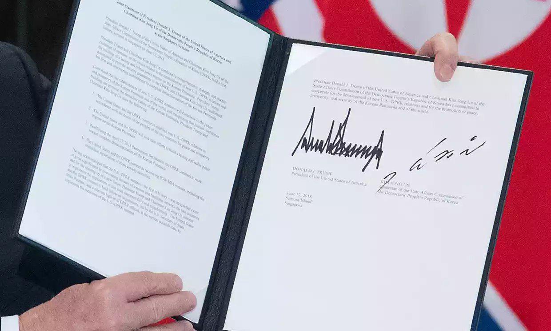 امضای رهبر کره شمالی و ترامپ پای سند مشترک (عکس)