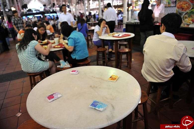 عجیب ترین شیوه رزرو کردن میز در سنگاپور (+عکس)