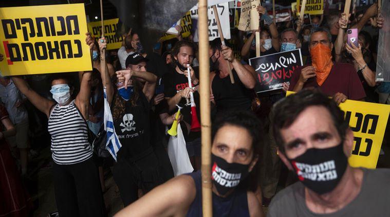 تظاهرات شهروندان اسرائیل علیه نتانیاهو(+عکس)/ نتانیاهو در دادگاه