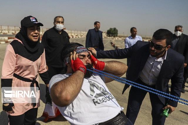 ثبت رکورد جهانی جابهجایی کامیون با دندان توسط 2 خوزستانی
