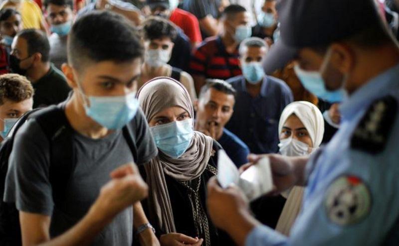 ماسک، راهکار مردم در منطقه شلوغ غزه