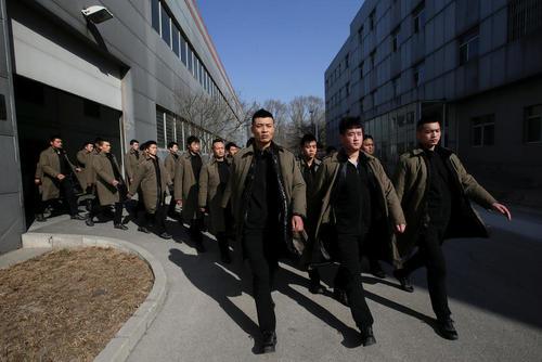 کارآموزان یک شرکت امنیتی خصوصی چین در حال تمرین – پکن