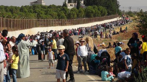 هزاران پناهجوی سوری ساکن ترکیه در حال عزیمت به کشورشان به منظور شرکت در آیین های عید قربان در زادگاهشان – مرز کیلیس بین ترکیه و سوریه