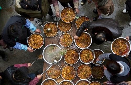 آمادهسازی غذا برای جشن سال نو چینی در شهر آنشون چین