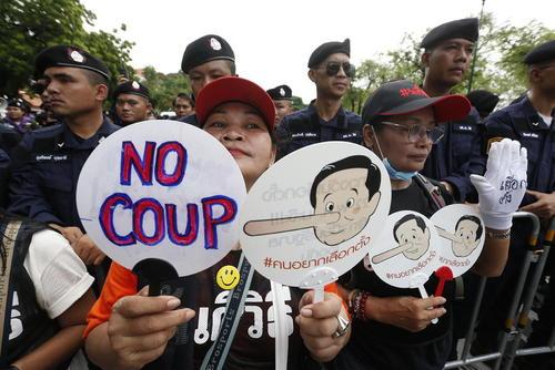 تظاهرات بر ضد نخست وزیر تایلند در چهارمین سالگرد کودتای نظامی در این کشور/ بانکوک
