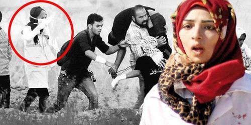 رزان النجار با لباس سفید پرستاری هدف گلوله تک تیرانداز اسراییلی قرار گرفت و به شهادت رسید.