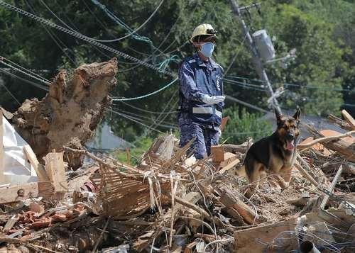 عملیات امداد و نجات مفقودان سیل در شهر کوره ژاپن/ خبرگزاری فرانسه
