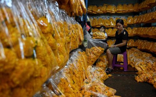 غرفهای در بازار گل در شهر بانکوک تایلند/ خبرگزاری فرانسه