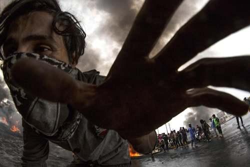 تظاهرات اعتراضی در شهر بصره عراق/ خبرگزاری فرانسه