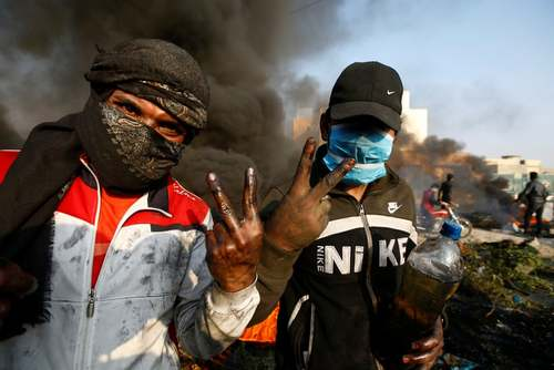 اعتراضات روز چهارشنبه در شهر نجف عراق/ رویترز