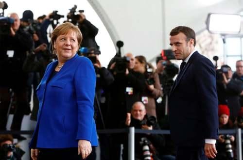 ال آنگلا مرکل صدراعظم آلمان از امانوئل ماکرون رییس جمهوری فرانسه در نشست لیبی در برلین/ رویترز