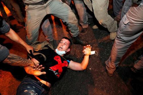تظاهرات بر ضد بیکفایتی و فساد نتانیاهو در شهر قدس/ رویترز