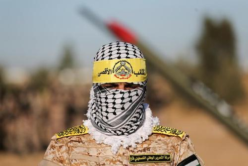 رژه شبه نظامیان جنبش فتح فلسطین در خان یونس غزه/ رویترز